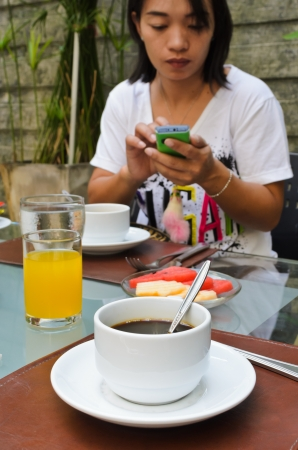 Morning Snacks and women communicate by phone  photo