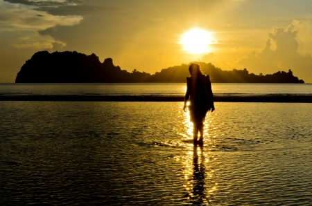 Girls playing on the beach at sunrise  Thailand photo