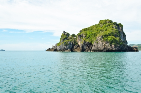singly: Small tropical island in the ocean,  for swallow nest harvesting, Thailand Stock Photo