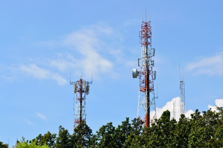 Multiplicity communications tower on the hill, beautiful sky background photo