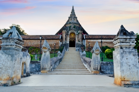 Arched entrance to Wat Phra That Lampang Luang temple, Historic site of Lampang province in northern Thailand photo