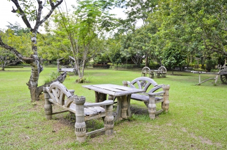 sward: Old wooden tables and bench for relaxing in the park