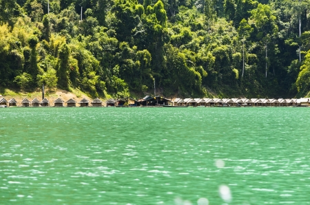 Small bungalow made of bamboo floating  Surrounded by mountains and water in Ratchaprapha Dam, Khao Sok National Park, Surat Thani Province, Thailand Stock Photo - 21049020