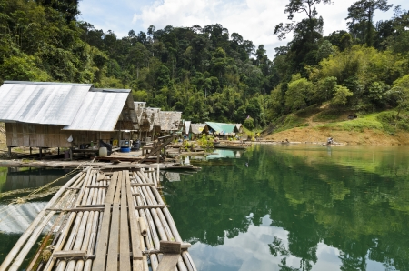 Floating home of the forest staff, Motor raft wharf in Ratchaprapha Dam at Khao Sok National Park, Surat Thani, Thailand photo