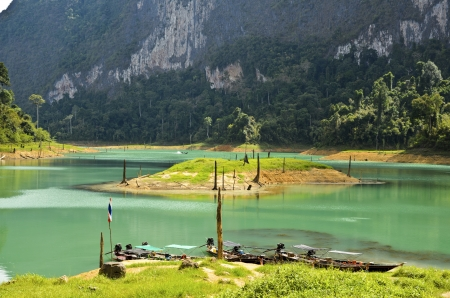 Beautiful mountains and river natural attractions in Ratchaprapha Dam at Khao Sok National Park, Surat Thani Province, Thailand photo