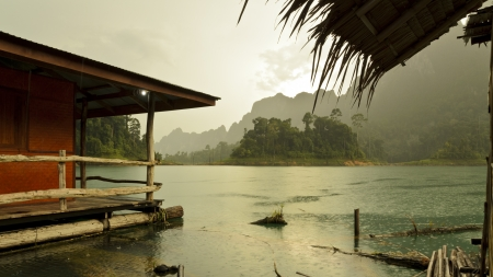 Mountain and river front of the hut while it was raining in Ratchaprapha Dam at Khao Sok National Park, Surat Thani Province, Thailand, 16 9 photo