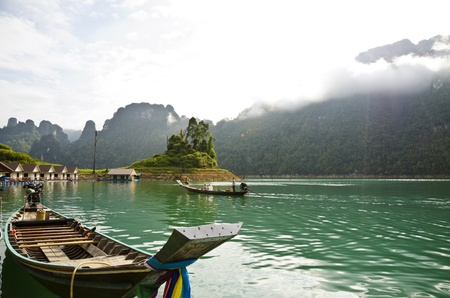 SURAT THANI, THAILAND - APR 27, 2013 : Tourist arrival by long tail boat in the morning at Ratchaprapha Dam at Khao Sok National Park, APR 27, 2013 in Thailand