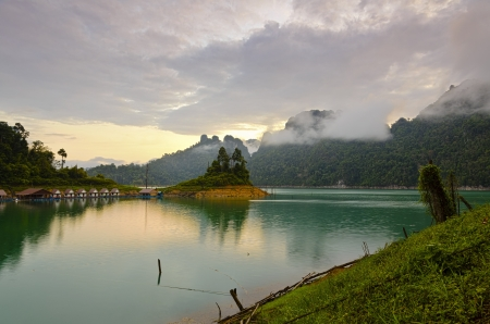 Villa mountains and rivers in the sunrise at Ratchaprapha Dam, Khao Sok National Park, Surat Thani Province, Thailand photo
