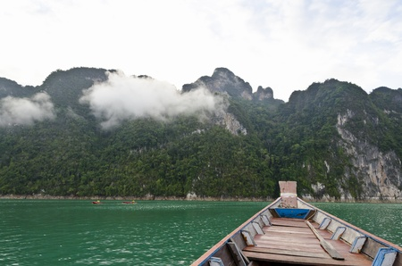 Travel by small boats in the morning at Ratchaprapha Dam, Khao Sok National Park, Surat Thani Province, Thailand photo