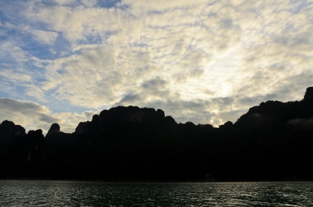 Beautiful sky mountains and river in the morning at Ratchaprapha Dam, Khao Sok National Park, Surat Thani Province, Thailand photo