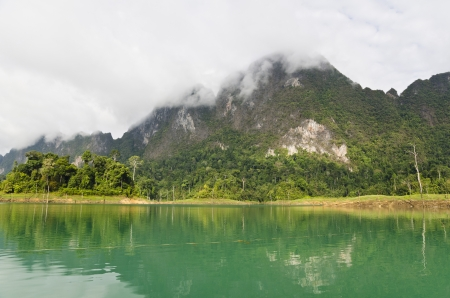 Beautiful mountains and river in the morning at Ratchaprapha Dam, Khao Sok National Park, Surat Thani Province, Thailand photo