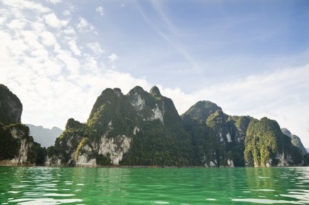 Beautiful high mountains and green river in the morning at Ratchaprapha Dam, Khao Sok National Park, Surat Thani Province, Thailand   Guilin of Thailand Stock Photo - 21558685