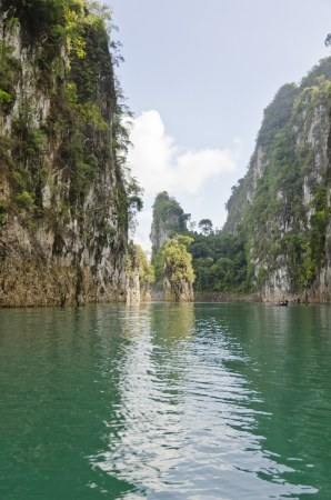 Beautiful high mountains and green river in the morning at Ratchaprapha Dam, Khao Sok National Park, Surat Thani Province, Thailand   Guilin of Thailand Stock Photo - 21571842