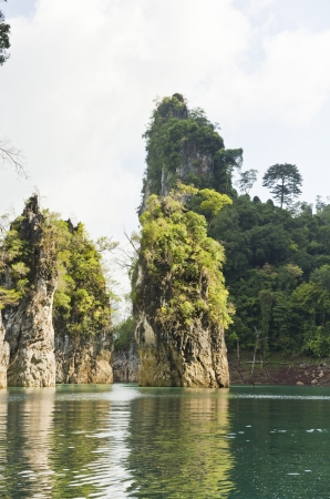 Beautiful high mountains and green river in the morning at Ratchaprapha Dam, Khao Sok National Park, Surat Thani Province, Thailand   Guilin of Thailand   photo