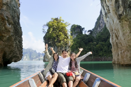 adventure holiday: Happy family boat trip on summer vacation in Ratchaprapha Dam, Khao Sok National Park, Surat Thani Province, Thailand   Guilin of Thailand