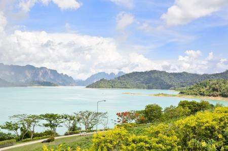 Beautiful landscape of river and mountains at Ratchaprapha Dam, Khao Sok National Park, Surat Thani Province, Thailand Stock Photo - 21698821