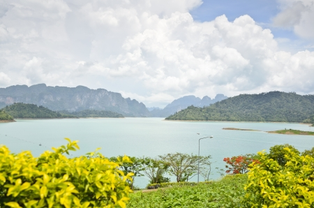 Beautiful landscape of river and mountains at Ratchaprapha Dam, Khao Sok National Park, Surat Thani Province, Thailand photo