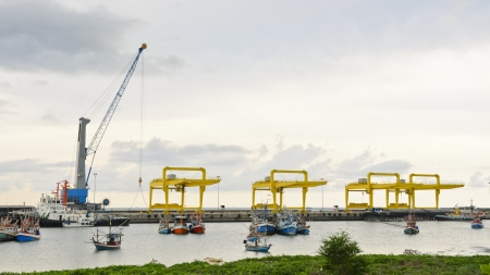 Crane for lifting a load up and down the ship  In deep water harbor area of Thailand, 16 9 photo