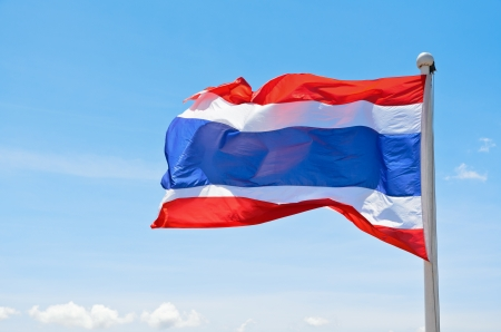 Thai flag waving in the wind on sky background photo