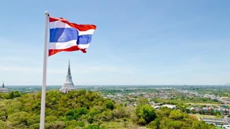 Thai flag waving on mountain in Phra Nakhon Khiri temple, archaeological site of Phetchaburi Province, Thailand  16 9 widescreen photo