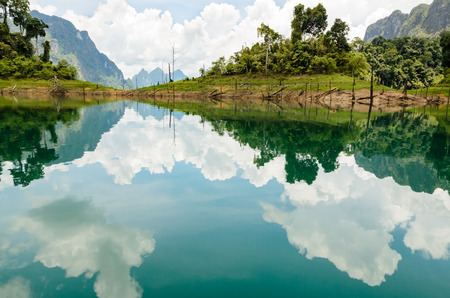 Water surface reflecting sky and cloud at Ratchapapha dam in Khao Sok National Park, Surat Thani province, Guilin of Thailand  photo