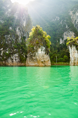 Beautiful island and green lake in the morning at Ratchaprapha Dam, Khao Sok National Park, Surat Thani Province, Thailand   Guilin of Thailand   photo