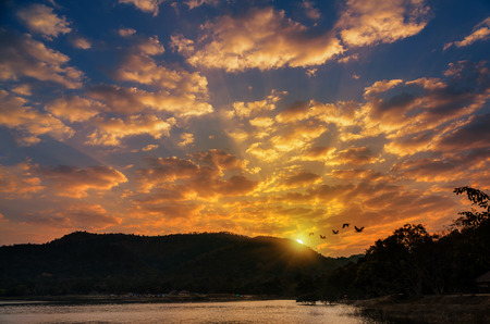 Sunrise over mountain by the lake at Kaeng Krachan National Park Phetchaburi province in Thailand photo