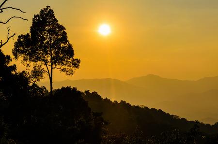 kaeng: Golden light of sunset over mountain range from Panoen Thung scenic point at Kaeng Krachan National Park Phetchaburi province in Thailand