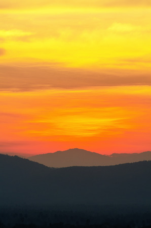 Beautiful orange and red sky over mountain range after sunset photo