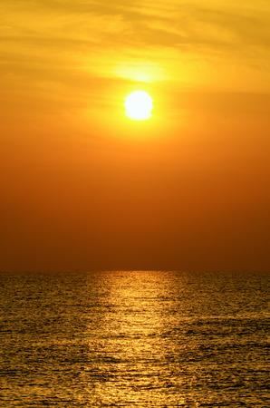 Beautiful of the sea and the sun at sunrise photo