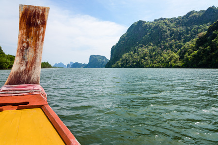 prow: Prow of the long tail boat is traveling at sea in Phang Nga Bay or Ao Phang Nga National Park Thailand