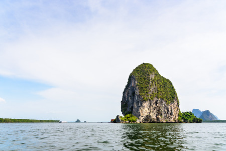 panyi: Beautiful landscape sky and sea. Back of Punyi Island or Koh Panyee during travel by boat in Phang Nga Bay or Ao Phang Nga National Park Thailand Stock Photo