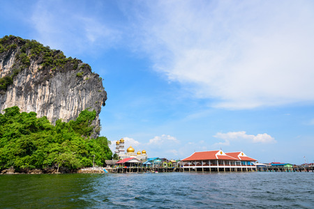 Beautiful landscape sea and blue sky in summer at Punyi Island or Koh Panyee is fisherman village cultural attractions travel by boat in Phang Nga Bay or Ao Phang Nga National Park Thailand photo