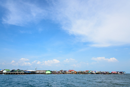 panyi: Blue sky background above fisherman village on the sea at Koh Panyee or Punyi island cultural attractions travel by boat in Phang Nga Bay or Ao Phang Nga National Park Thailand