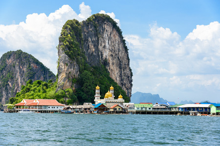 Beautiful landscape sea and blue sky in summer at Punyi Island or Koh Panyee is fisherman village cultural attractions travel by boat in Phang Nga Bay or Ao Phang Nga National Park Thailand