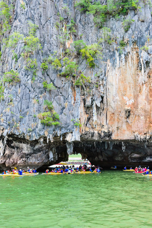 phang nga: PHANG NGA THAILAND  APRIL 27 2015: Tourists are happy with the canoeing near island on the sea surface at Tham Lod cave in Ao Phang Nga Bay National Park APRIL 27 2015 in Thailand