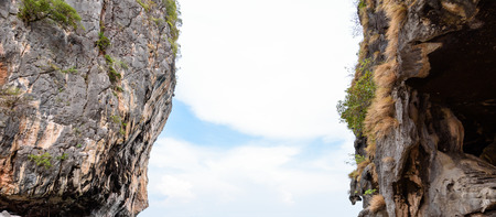 bridging the gap: Two stone cliff with a space middle and see the sky