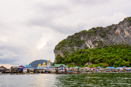 panyi: Landscape Koh Panyee or Punyi island village is floating over the sea during a boat tour at the Ao Phang Nga Bay National Park Thailand