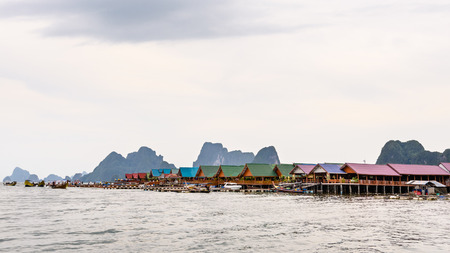 wide screen: Pier and restaurants floating over the sea at Punyi Island or Koh Panyee during a boat tour in the Ao Phang Nga Bay National Park Thailand 16:9 wide screen
