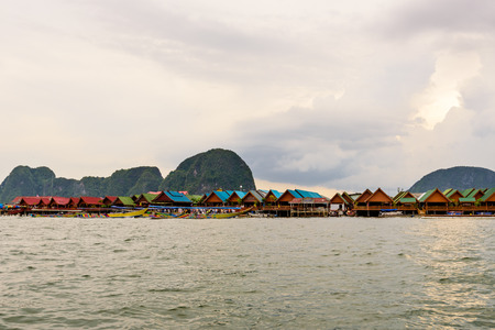 Beautiful landscape of sea at Punyi Island or Koh Panyee floating village in the evening during a boat tour at the Ao Phang Nga Bay National Park Thailand Stock Photo