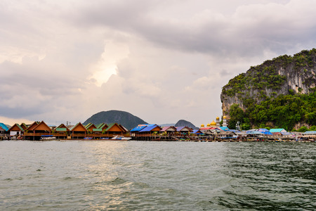 ao: Beautiful landscape of sea at Punyi Island or Koh Panyee floating village in the evening during a boat tour at the Ao Phang Nga Bay National Park Thailand Stock Photo