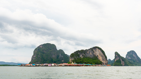 Beautiful landscape sea at Punyi Island or Koh Panyee is fisherman village cultural attractions in during a boat tour at the Ao Phang Nga Bay National Park Thailand 16:9 wide screen