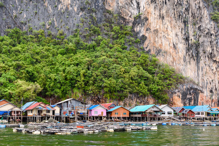 Landscape Koh Panyee or Punyi island home is floating over the sea during a boat tour at the Ao Phang Nga Bay National Park Thailand