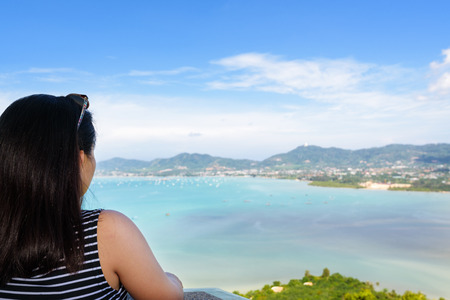 famous women: Back side the women tourist looking at beautiful landscape of sea and island on Khao Khad mountain viewpoint famous attractions in Phuket Province, Thailand