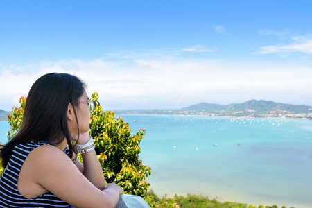 famous women: Side of the women tourist looking at beautiful nature sea and island on Khao-Khad mountain viewpoint famous attractions in Phuket Province, Thailand Stock Photo