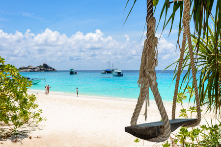 praised: Swing on the beach at Koh Miang island is highly praised for its beautiful scenery of sea in Mu Ko Similan National Park, Phang Nga Province, Thailand Stock Photo