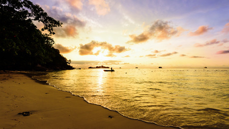 golden light: Beautiful landscapes of golden light the sky over the beach and sea during sunrise on Koh Miang Islands, Mu Ko Similan National Park, Phang Nga, Thailand, 16:9 widescreen