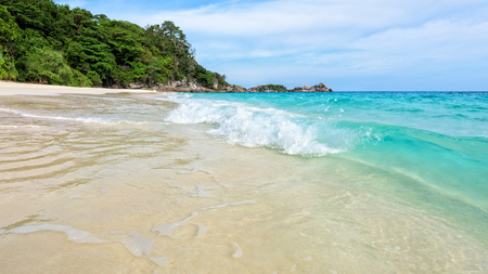 blue widescreen widescreen: Beautiful landscape blue sea white sand and waves on the beach during summer at Koh Miang island in Mu Ko Similan National Park, Phang Nga province, Thailand, 16:9 widescreen Stock Photo