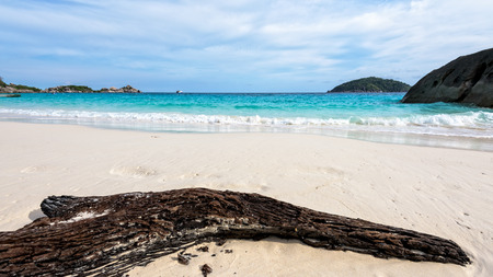 blue widescreen widescreen: Old driftwood blue sea white sand and waves on the beach, beautiful nature during summer at Koh Miang island in Mu Ko Similan National Park, Phang Nga province, Thailand, 16:9 widescreen