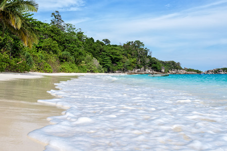 phang nga: Beautiful nature of blue sea sand and white waves on the beach during summer at Koh Miang island in Mu Ko Similan National Park, Phang Nga province, Thailand Stock Photo
